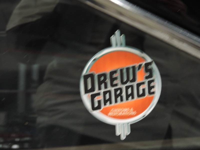 logo for Drew's Garage